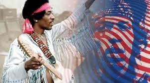 Jimi Hendrix with his guitar plays Star Spangled Banner in Woodstock